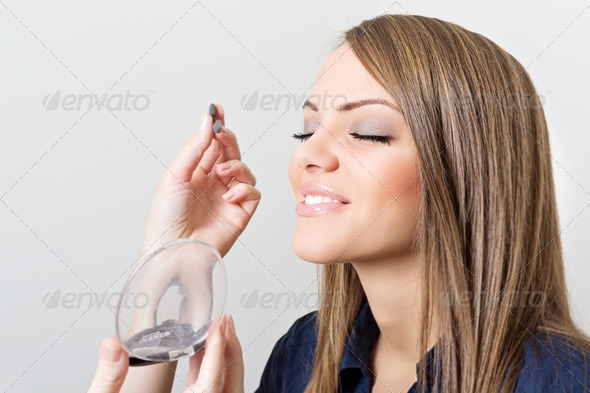 Makeup artist applying eye shadow to beautiful model - Stock Photo - Images