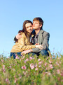 Outdoor Portrait of young couple against the sky - PhotoDune Item for Sale