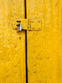 Padlock on an old yellow door - PhotoDune Item for Sale