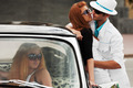 Young couple in love and jealous girl in a classic car - PhotoDune Item for Sale