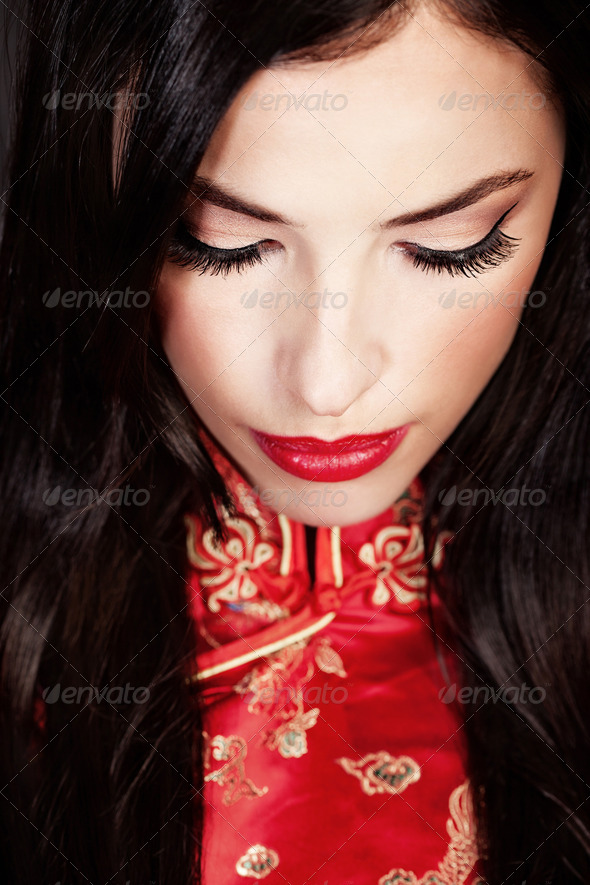 woman in red Cheongsam - Stock Photo - Images