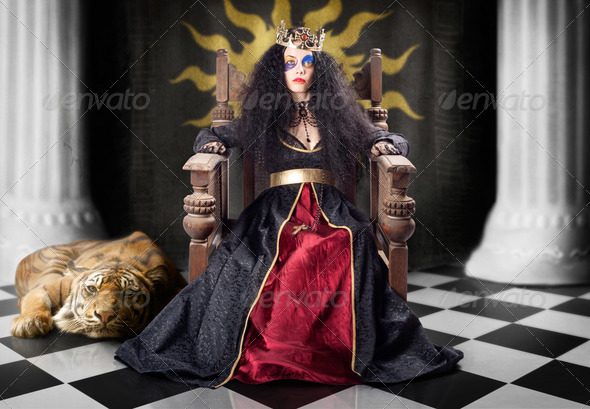 Fashion queen in crown sitting in jester court - Stock Photo - Images