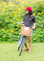 Woman with retro bicycle in a park - PhotoDune Item for Sale