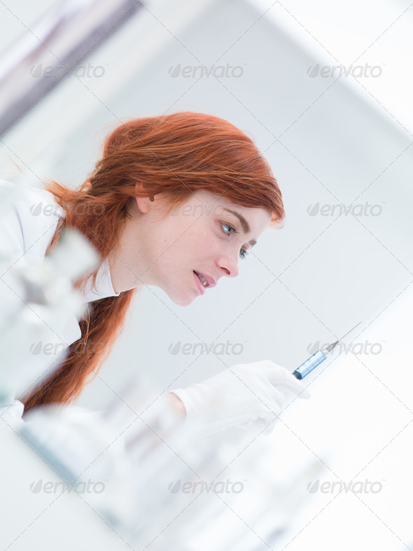woman  preparing injection - Stock Photo - Images