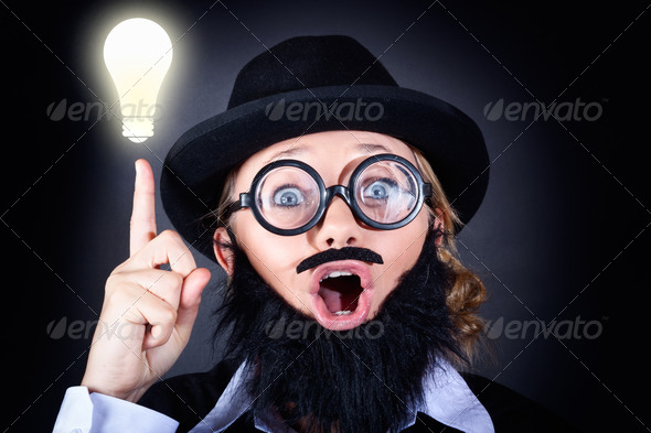 Mad professor with light bulb breakthrough - Stock Photo - Images