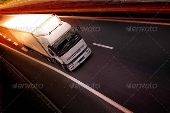 A white truck on highway - delivery concept - Stock Photo - Images
