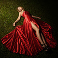 Beautiful Lady In Red Dress Lying On Green Grass - PhotoDune Item for Sale