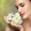 Beauty Face Of The Young Beautiful Woman With Flower. - PhotoDune Item for Sale