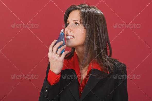 Woman Smelling Perfume - Stock Photo - Images