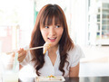 Asian girl eating dim sum - PhotoDune Item for Sale