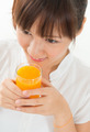 Asian female drinking orange - PhotoDune Item for Sale