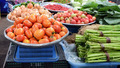 Baskets of tomatoes and vegetable at a farmer's market. - PhotoDune Item for Sale