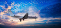 Small private jet in a sunset sky - PhotoDune Item for Sale