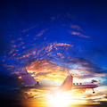 Small private jet in sunset sky - PhotoDune Item for Sale