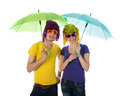Funny couple with wigs, sunglasses and umbrellas - PhotoDune Item for Sale