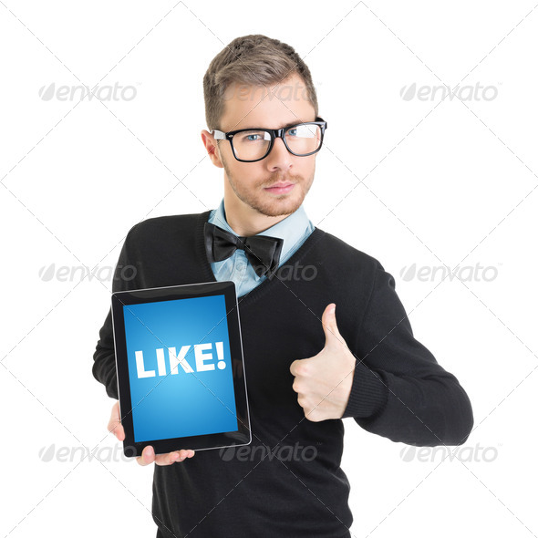 Elegant businessman holding digital tablet that states like - Stock Photo - Images