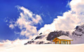Wooden cottage and buried hut on peak of Snow Mountain - PhotoDune Item for Sale