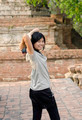 Asian woman at Wat Maheyong Temple. Ayutthaya - Thailand - PhotoDune Item for Sale