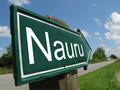Nauru arrow signpost along a rural road - PhotoDune Item for Sale