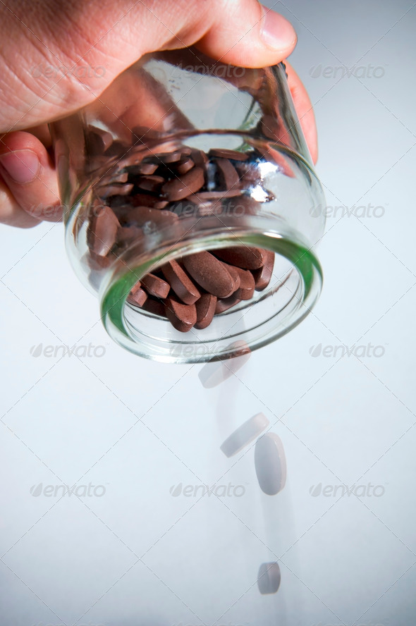Pouring out Pills - Stock Photo - Images