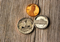 US cent coins over wooden background - PhotoDune Item for Sale