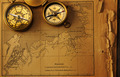 Antique compass over old map - PhotoDune Item for Sale