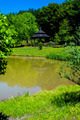 water reflects nature with gazebo in distance - PhotoDune Item for Sale