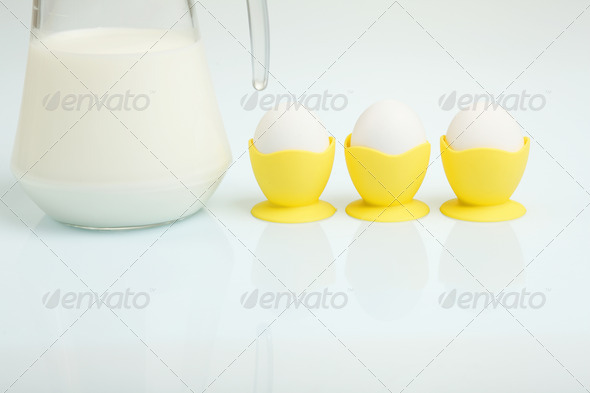 Milk in a glass jar and eggs - Stock Photo - Images
