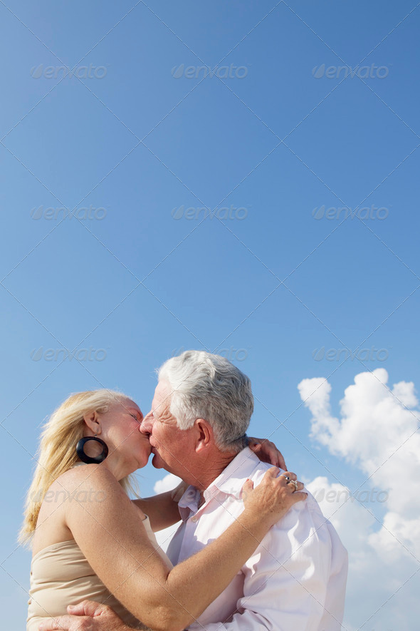 Active retired people, romantic elderly couple in love and kissi - Stock Photo - Images