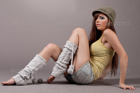 Pretty female model sitting and woolen leggings - Stock Photo - Images