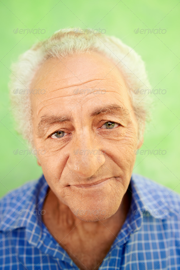 Portrait of happy elderly caucasian man smiling at camera - Stock Photo - Images