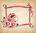 Holiday background with three roses and gift box and ribbon. - PhotoDune Item for Sale