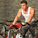 Handsome Man Riding a Bike in Gym - VideoHive Item for Sale