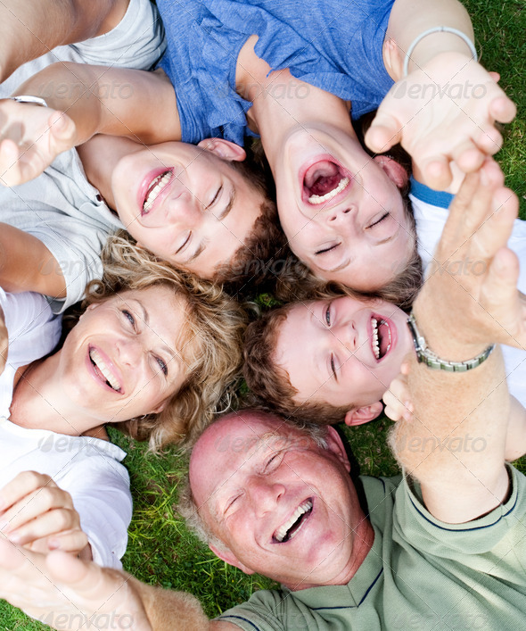 Multi-generation family lying in circle - Stock Photo - Images