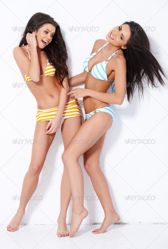 Two cute brunette girl having fun - Stock Photo - Images
