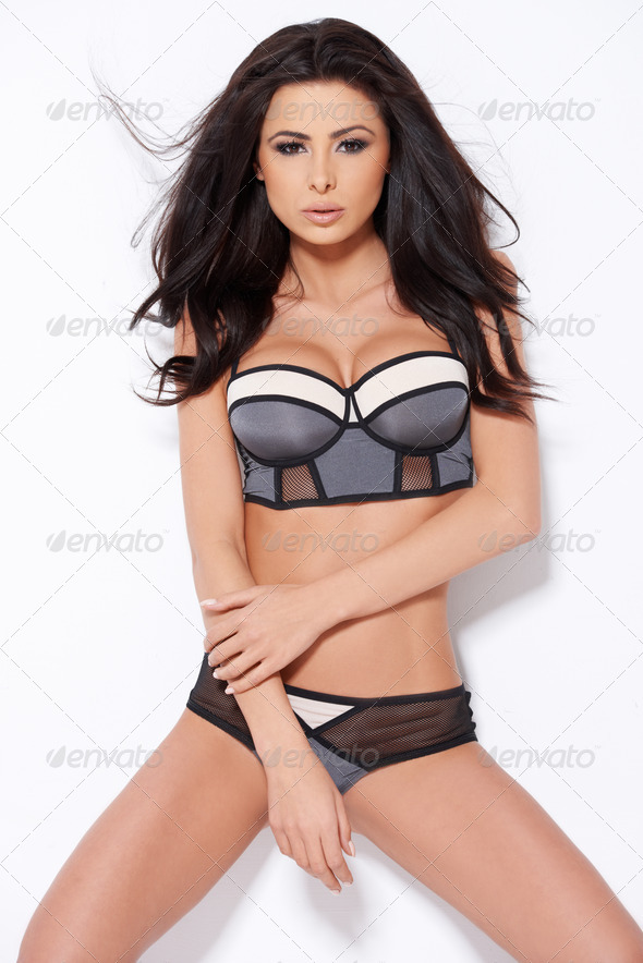 Adorable brunette posing on white - Stock Photo - Images