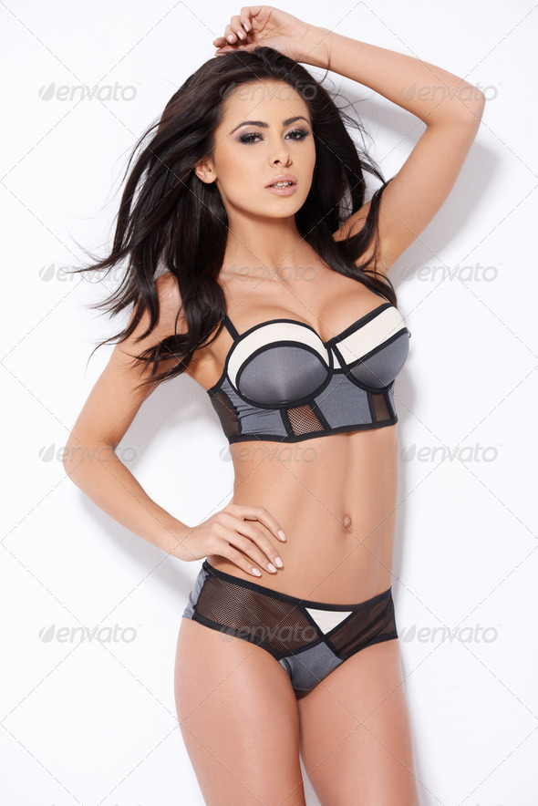 Sexy brunette girl posing in lingerie - Stock Photo - Images