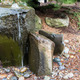 A bubbling water fountain in a garden - PhotoDune Item for Sale