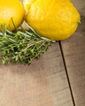 Lemons and herbs on a wooden table - PhotoDune Item for Sale