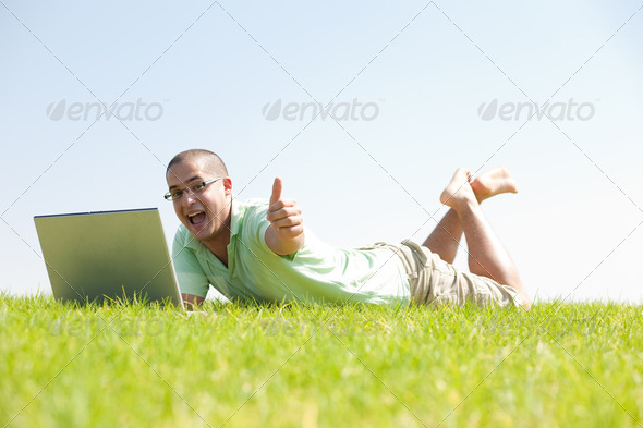 Laptop in the Park - Stock Photo - Images