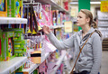 Young woman is choosing toys for her kid. - PhotoDune Item for Sale