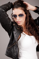 Attractive model wearing sunglasses - PhotoDune Item for Sale