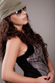 Side pose of a woman with sunglasses and cap - PhotoDune Item for Sale