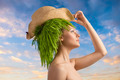 woman in profile with eco hair-style and hat - PhotoDune Item for Sale