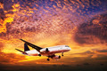Jet in spectacular sunset sky - PhotoDune Item for Sale