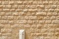 Texture of the wall built of rough yellow stone blocks - PhotoDune Item for Sale