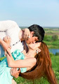 summer outdoor portrait of a young couple kissing - PhotoDune Item for Sale
