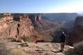 Man Taking a Photo of Shafer Trail Road in Canyonlands National Park - PhotoDune Item for Sale