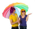 Funny dressed couple with umbrella looking for rain - PhotoDune Item for Sale