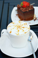 Cup of coffee with a chocolate cake on the white plate - PhotoDune Item for Sale